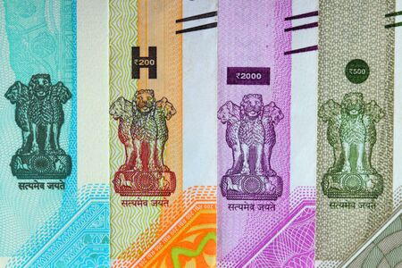 National emblem of India on different currency notes