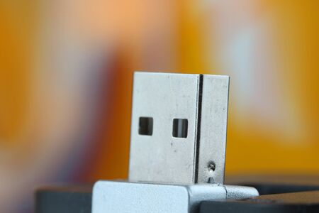 Close up shot of USB against colorful background Stock Photo