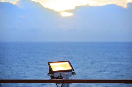 Flood light focused to the sky on boat Banco de Imagens