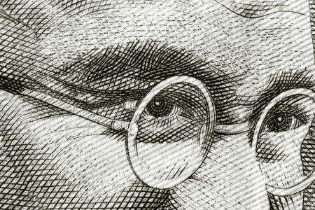 Close up shot of Gandhi on rupee note Editorial