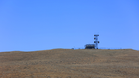Communication tower on the hill in rural Utah Stock Photo - 124622151