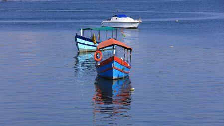 Colorful boats in Arabian sea near Old Goa in India Stock Photo