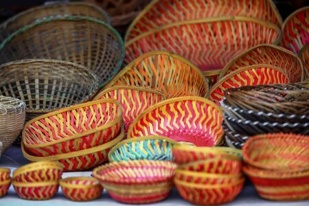 Many colorful weaved baskets up for sale