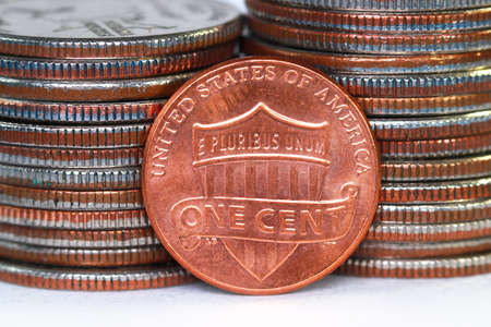 Close up shot of American one cent coin against quarter coins