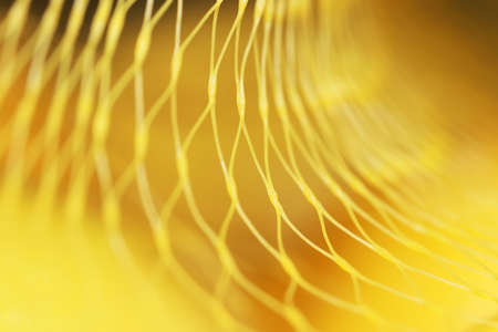 Close up shot of yellow nylon net with selective focus for background use