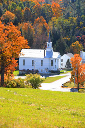 Historic church in West Barnet village in Vermont during autumn time Фото со стока