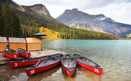 Scenic Emerald lake shore with Canoes fore end in British Columbia, Canada