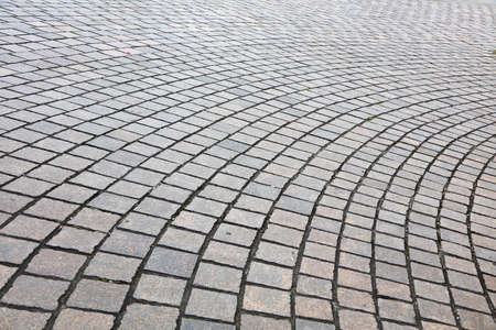 Pattern of paved cobble stones on a curve path