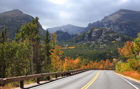 Fall foliage along scenic Bear lake road in Colorado during stormy weather