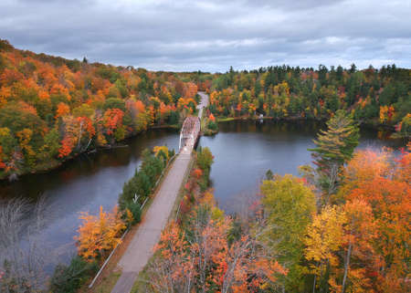 Aerial view of McClure storage basin with old 510 bridge surrounded by fall foliage