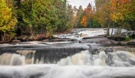 Scenic Upper Bond falls near Paulding in Michigan upper peninsula in autumn time.