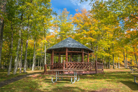 Wooden Gazebo in Presque Isle state park near Marquette in Michigan upper peninsula during autumn time.