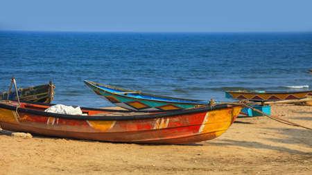 Colorful fishermen boats at Rushikonda beach near Visakhapatnam city in India.