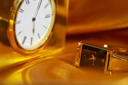 Close up shot of golden watch and clock