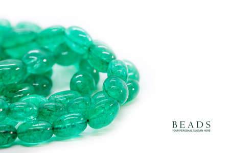 Close up shot of Green glass beads on a chain with copy space place holder text