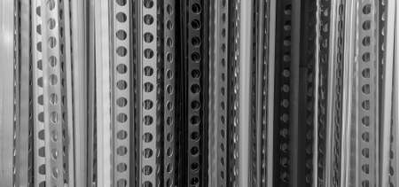 Row of many perforated angle metal beads