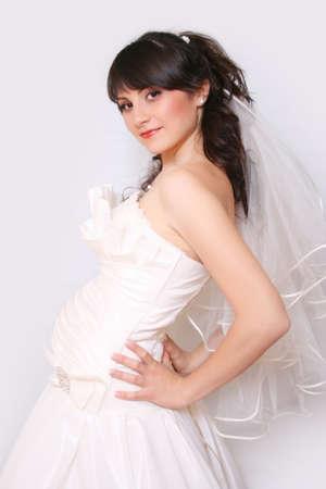 Eine schwangere Braut auf weißem Hintergrund Standard-Bild
