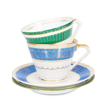 elegantly: two teacups with saucers