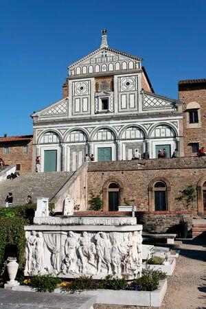 tumb: An artistic tumb in the cemetery of romanic church of San Miniato al Monte (back) in Florence, Italy Stock Photo