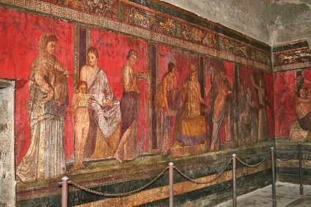 Photo of a wall painting in the Villa of Mysteries that depict a woman being inducted into the Dionysiac cult or perhaps preparing for marriage. This is one of Pompeiis most luxurious, with particularly elaborate wall paintings.The Villa is a Pompeii mus