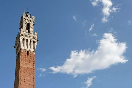 The tower of the Palazzo Pubblico of Siena from below. Stock Photo - 591223