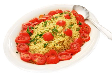Traditional Indian rice dish with jeera (cumin) basmati rice and tomatos, Stock Photo
