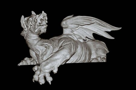 A marble dragon that can be used as a decorative element on a frame Stock Photo - 590907