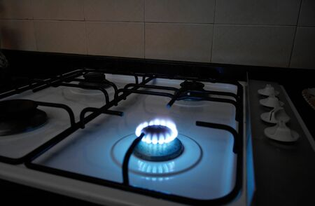 A natural gas burner from a stove in a kitchen Stock Photo