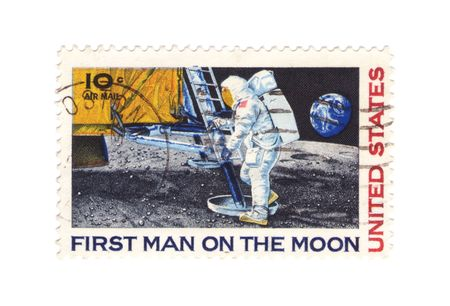 A vintage US stamp commemorating the first man on the moon Stock Photo