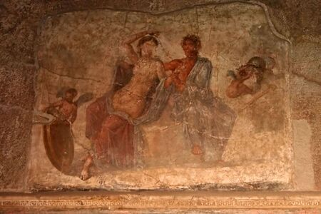 depict: A photo of a wall painting in a aristocratic house of Pompeii. The pait depict a woman and man with