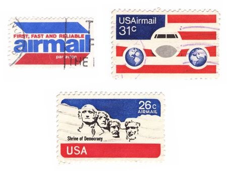 A collection of vintage US stamps: airmail, flag, Mt.Rushmore...