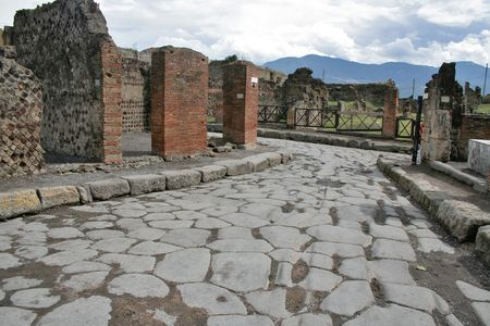cobblestone street: An antique roman stone street through ruins of Pompeii,Italy.