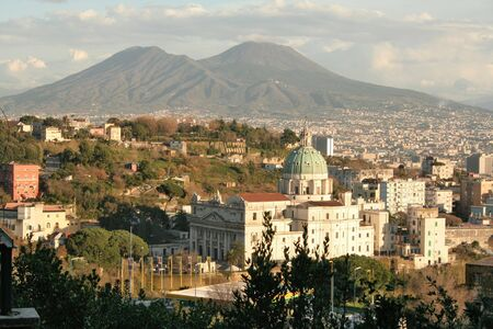 View of Mt.Vesuvius, an active volcano in Naples, with the church Madre del Buon Consiglio