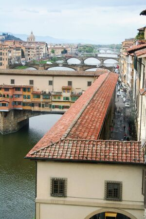 Ponte Vecchio (old bridge) in Florence Italy. This is a two floor bridge: the upper floor was reserved to governors and vip.They moved from Uffizi palace to the pubblic hall with this reserved passage. Stock Photo