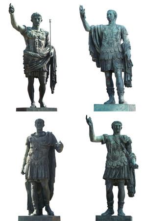 Four Roman Emperors statues (Augustus Caesar, Julius Caesar,Nerva and Trajan). Bronce, isolated on white. Rome, Italy.