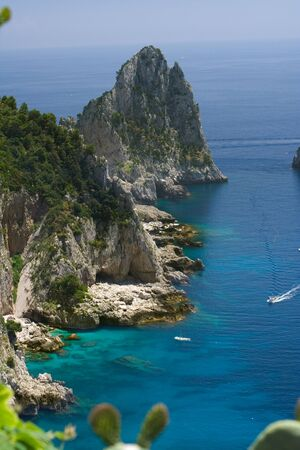 View of the coastline of the island of Capri, Italy, with one of its seaside rock formations known as the Faraglioni Stock Photo