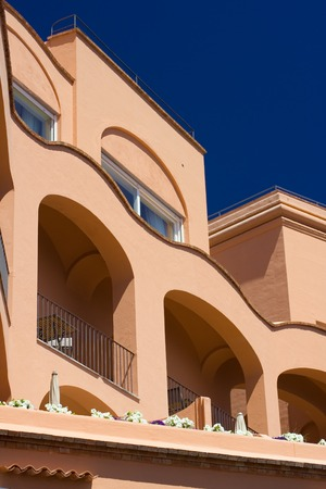 southern europe: Summer house or hotel in Capri, Italy. View from below against deep blue sky.