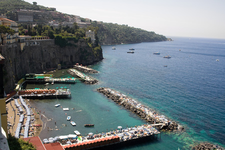 Beach in Sorrento, Italy. People sunbathing and swimming.