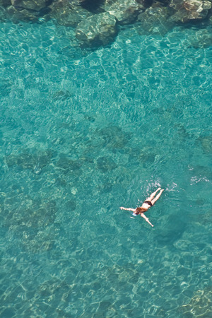 Girl snorkeling in Sorrento, Italy. Top view