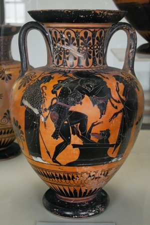 An ancient greek vase with mythological paintings (black on red) Stock Photo