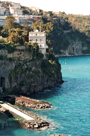 Rocky coastline in Sorrento with its wonderful villas on high cliffs overllooking the sea Stock Photo