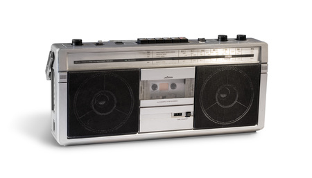 Vintage 80s boom box stereo isolated on white with shadows.
