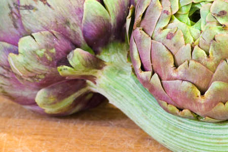 Artichokes arrangement on a wood table (with shallow dof)