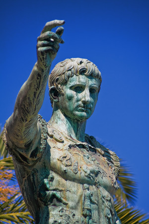 Statue of Augustus Caesar close-up agaist blue sky.