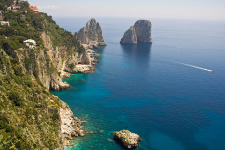 The Faraglioni in Capri (famous seaside rock formations). View of the coastline of the island of Capri, Italy