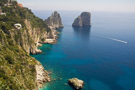 The Faraglioni in Capri (famous seaside rock formations). View of the coastline of the island of Capri, Italy