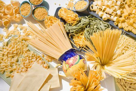 messed: Italian raw pasta messed up: spaghetti, tagliatelle, macaroni, fettuccine, ribbons, lasagna, orecchiette, conchiglie, tubes, etc....