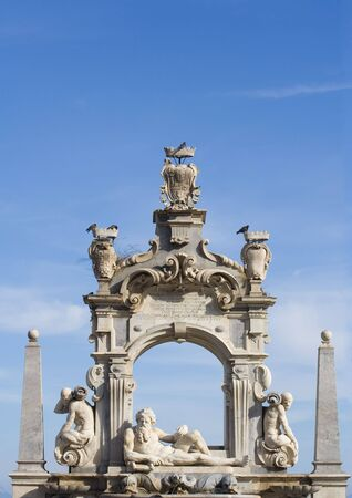 Baroque sculpture fountain in Naples, Italy. Against blue sky with room for copy space.