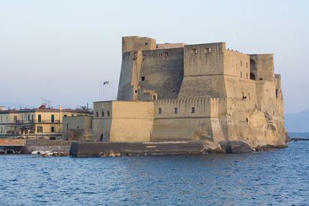 edifice: Castel dellOvo (Egg Castle) a medieval castle in the bay of Naples, Italy. The edifice is located on a small island.