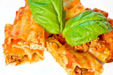 Waved Cannelloni with meat, ricotta cheese and tomato  sauce. Italian traditional food. Stock Photo
